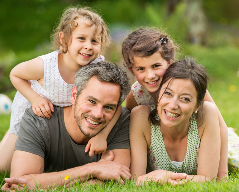 Smiling Family on Banner Image | Hollywood Smile Dental